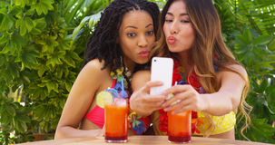 black-asian-women-taking-selfie-tropical-vacation-friends-47559296